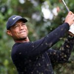 Woods bogeys first three holes in Japan - but fights back to share lead