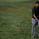 Tiger Woods adjusts to compete without fans