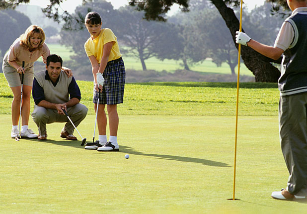 Children Learning To Play Golf