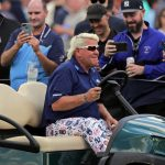 John Daly still drives behind the T-shirt and wheel after all those years.